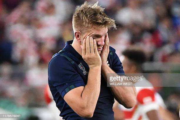 Scotland's centre Chris Harris reacts after his team lost the Japan 2019 Rugby World Cup Pool A match between Japan and Scotland at the International...