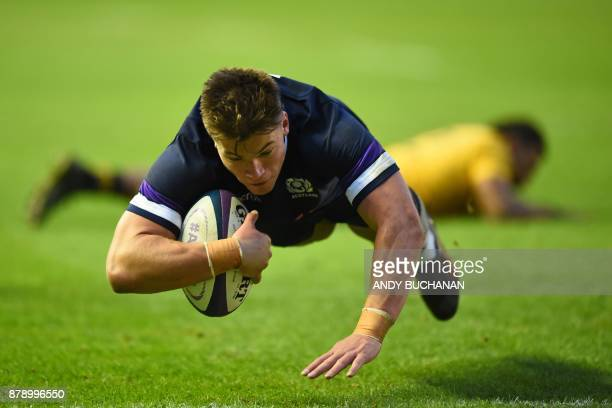 TOPSHOT Scotland's centre Huw Jones dives over the line to score a try during the autumn international rugby union test match between Scotland and...