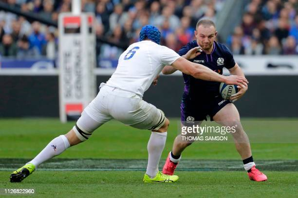 Scotland's centre Nick Grigg runs to evade France's flanker Wenceslas Lauret during the Six Nations rugby union tournament match between France and...