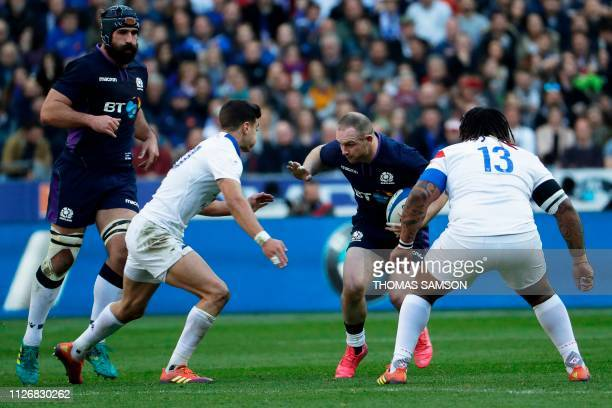 Scotland's centre Nick Grigg runs with the ball during the Six Nations rugby union tournament match between France and Scotland at the Stade de...