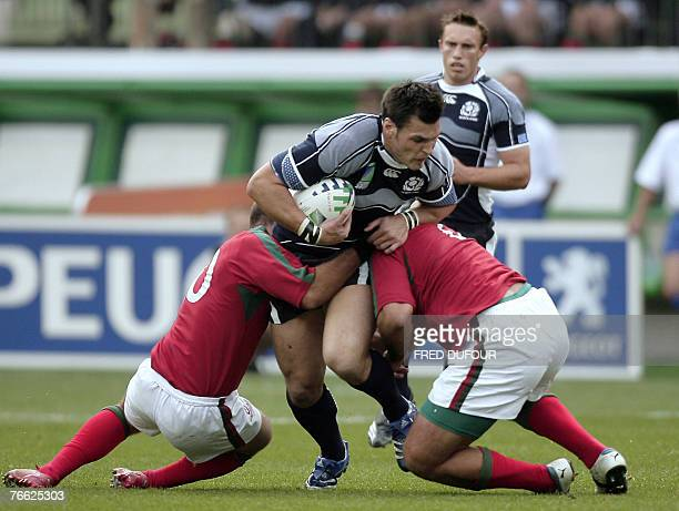 Scotland's centre Rob Dewey is tackled by Portugal's flanker Juan Severino Somoza during the rugby union World Cup match Scotland vs Portugal, 09...
