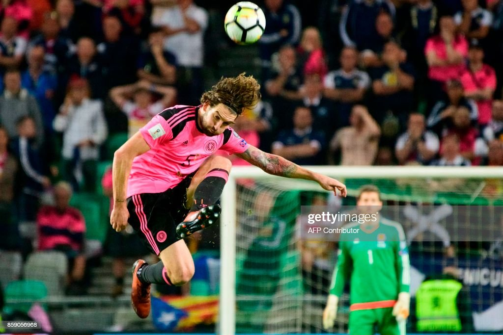 TOPSHOT - Scotland's Charlie Mulgrew kicks the ball during the FIFA World Cup 2018 qualifier football match between Slovenia and Scotland at the Stozice stadium in Ljubljana, on October 8, 2017. / AFP PHOTO / Jure Makovec