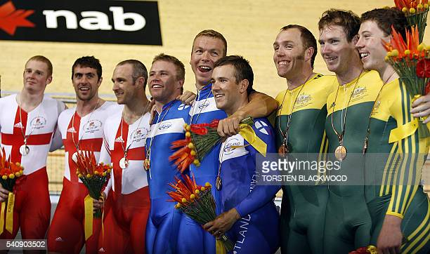 Scotland's Chris Hoy Craig Maclean and Ross Edgar share the podium with Enland's silver medalists Matthew Crampton Jason Queally and Jamie Staff and...