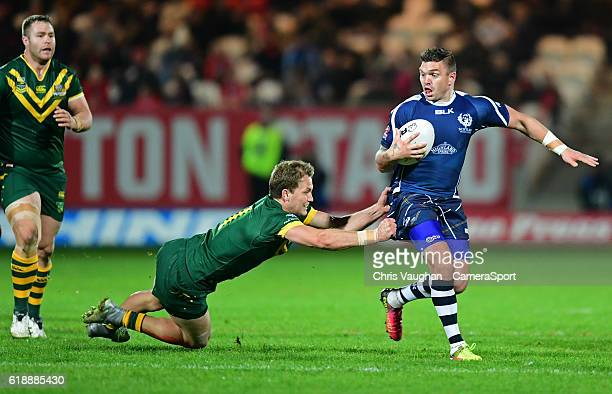 Scotland's Danny Brough is tackled by Australia's Matt Moylan during the Four Nations match between the Australian Kangaroos and Scotland at...
