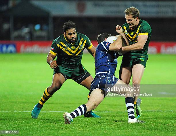 Scotland's Danny Brough is tackled by Australia's Sam Thaiday and Australia's Jake Trbojevic during the Four Nations match between the Australian...