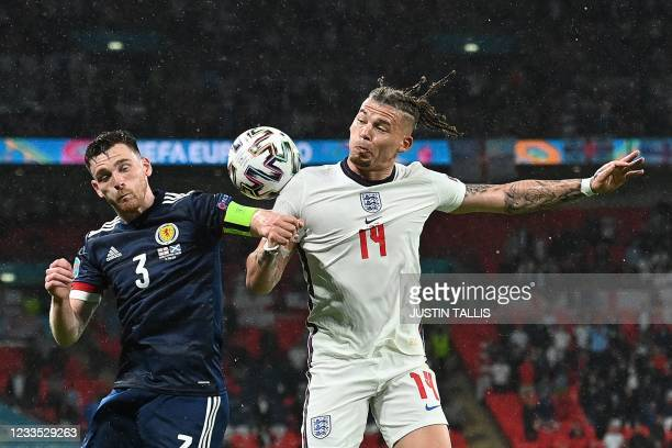 Scotland's defender Andrew Robertson and England's midfielder Kalvin Phillips vie for the ball during the UEFA EURO 2020 Group D football match...