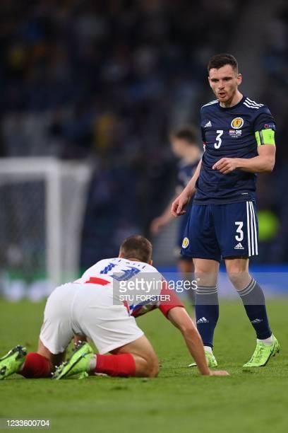 Scotland's defender Andrew Robertson exchanges words with Croatia's midfielder Nikola Vlasic during the UEFA EURO 2020 Group D football match between...