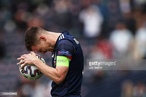 Scotland's defender Andrew Robertson reacts after the UEFA EURO 2020 Group D football match between Scotland and Czech Republic at Hampden Park in...