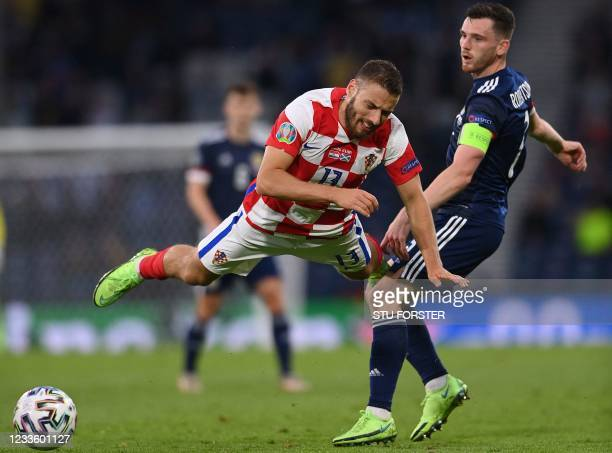 Scotland's defender Andrew Robertson vies for the ball with Croatia's midfielder Nikola Vlasic during the UEFA EURO 2020 Group D football match...