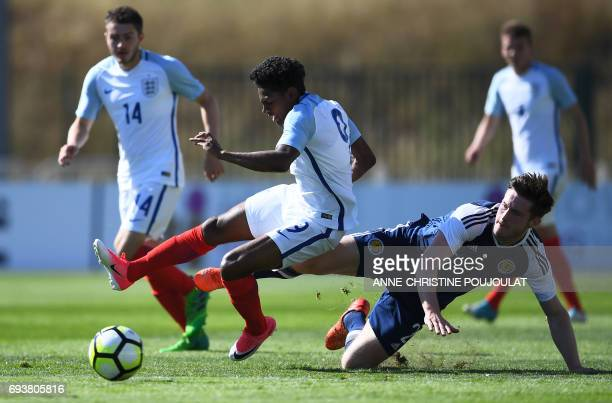 Scotland's defender Anthony Ralston tackles England's midfielder Demetri Mitchell during the Under 21 international football semi final match...