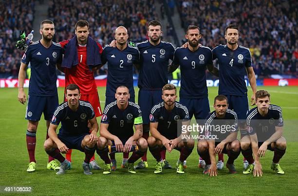 Scotland's defender Charlie Mulgrew Scotland's goalkeeper David Marshall Scotland's defender Alan Hutton Scotland's defender Grant Hanley Scotland's...