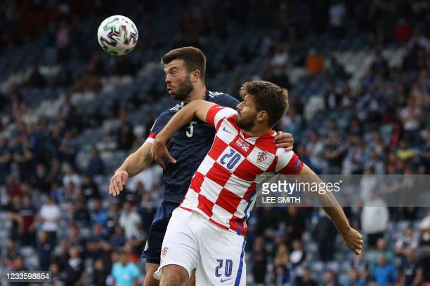 Scotland's defender Grant Hanley heads the ball ahead of Croatia's forward Bruno Petkovic during the UEFA EURO 2020 Group D football match between...