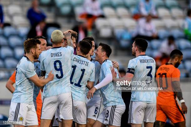Scotland's defender Jack Hendry is congratulated by teammates for his goal during the international friendly football match between Netherlands and...