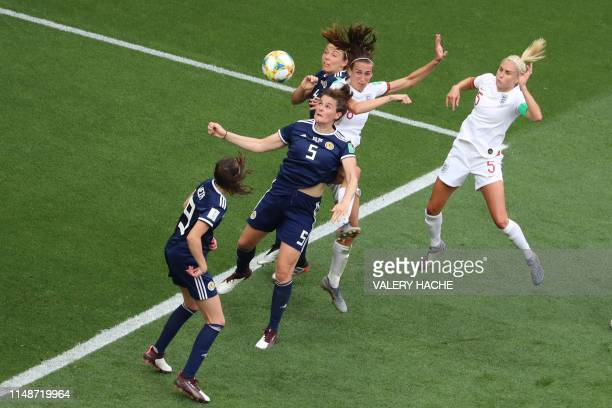Scotland's defender Jennifer Beattie jumps for the ball with England's midfielder Jill Scott during the France 2019 Women's World Cup Group D...