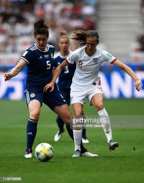 Scotland's defender Jennifer Beattie vies for the ball with England's midfielder Jill Scott during the France 2019 Women's World Cup Group D football...