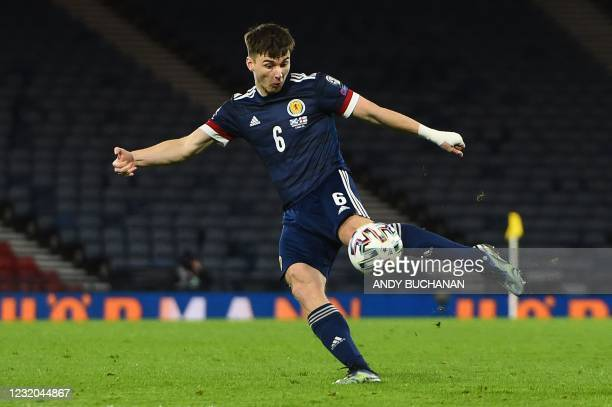 Scotland's defender Kieran Tierney crosses the ball allowing Scotland's midfielder John McGinn to score their second goal during the FIFA World Cup...
