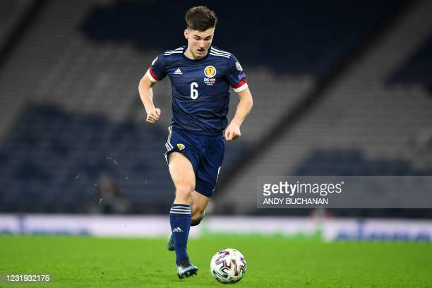 Scotland's defender Kieran Tierney runs with the ball during the FIFA World Cup Qatar 2022 qualification football match between Scotland and Austria...