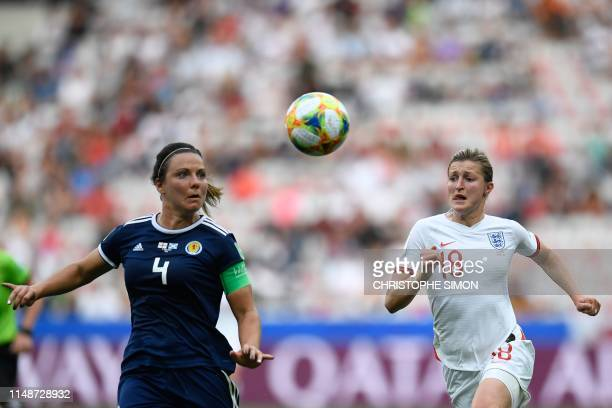 TOPSHOT Scotland's defender Rachel Corsie vies for the ball with England's forward Ellen White during the France 2019 Women's World Cup Group D...