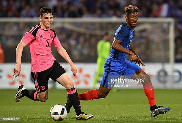 Scotland's defender Russell Martin vies with France's forward Kingsley Coman during the friendly football match France vs Scotland at the St...
