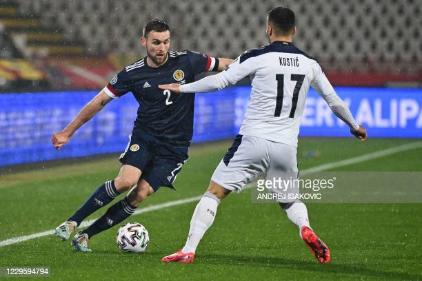 Scotland's defender Stephen O'Donnell fights for the ball with Serbia's midfielder Filip Kostic during the Euro 2020 play-off qualification football...