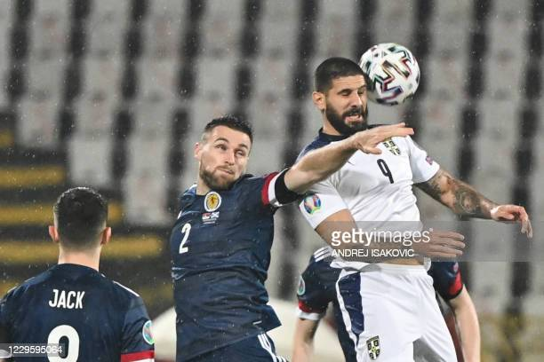 Scotland's defender Stephen O'Donnell fights for the ball with Serbia's forward Aleksandar Mitrovic during the Euro 2020 play-off qualification...