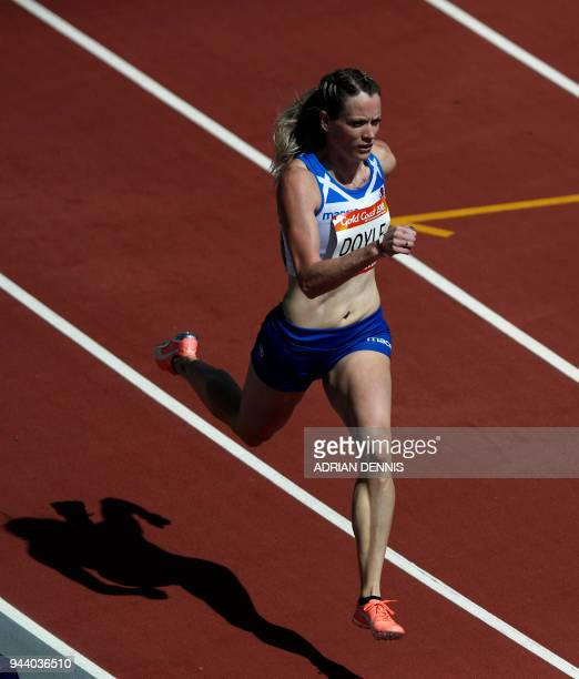 Scotland's Eilidh Doyle competes in the athletics women's 400 metres hurdles round 1 during the 2018 Gold Coast Commonwealth Games at the Carrara...