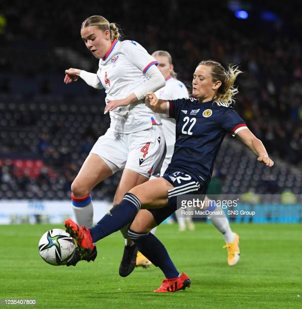 Scotland's Erin Cuthbert competes with Maria A Lakjuni during a FIFA World Cup Qualifier between Scotland and Faroe Islands at Hampden Park on...