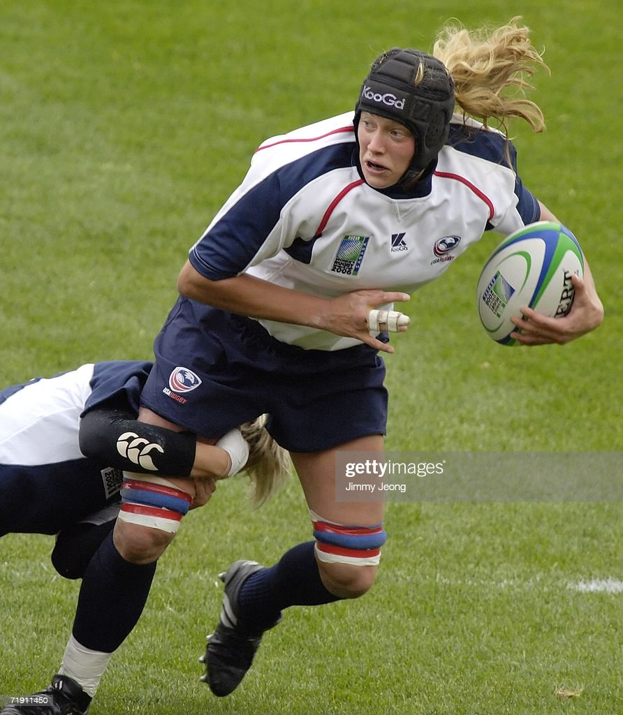 Scotland's Erin Kerr #10 tries to tackle Erin Carter #4 (R) of the USA in the Fifth-place match during day six of the Women's Rugby World Cup 2006 at Commonwealth Stadium on September 17, 2006 in Edmonton, Alberta, Canada.