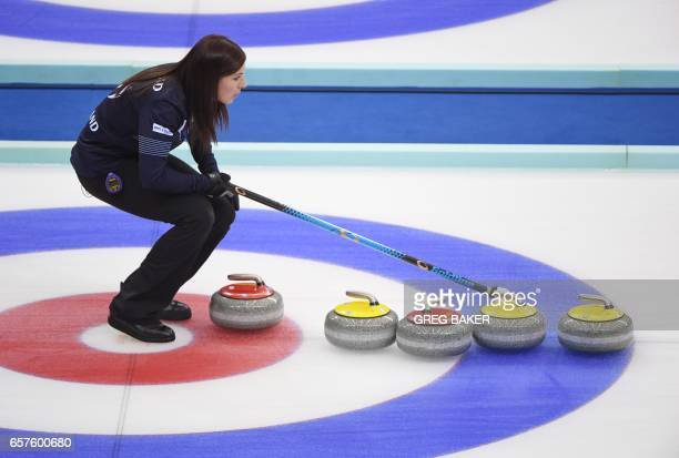 Scotland's Eve Muirhead stands behind stones during their playoff against Sweden at the Women's Curling World Championships in Beijing on March 25...
