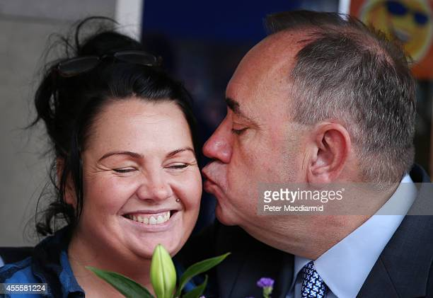 Scotland's First Minister Alex Salmond kisses flower seller Katrina Paterson in the East Kilbride shopping centre on September 17 2014 in Glasgow...