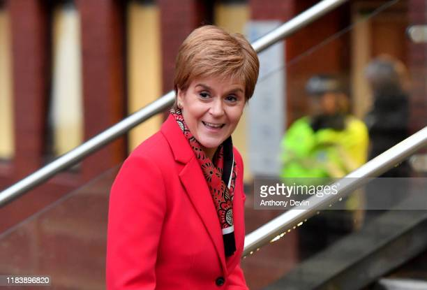 Scotland's First Minister and and leader of the Scottish National Party Nicola Sturgeon walks with Editorial Director of BBC News Kamal Ahmed as she...