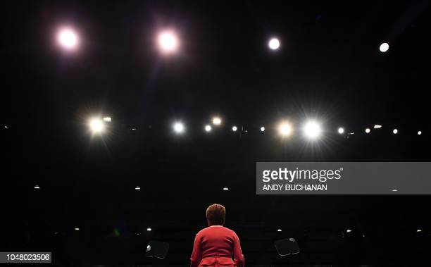 TOPSHOT Scotland's First Minister and leader of the Scottish National Party Nicola Sturgeon delivers her keynote speech to delegates on the final day...