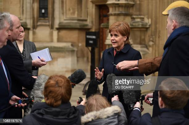 Scotland's First Minister and Leader of the Scottish National Party Nicola Sturgeon speaks to members of the media outside the Houses of Parliament...