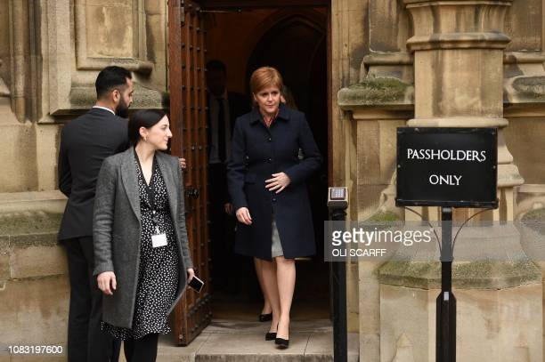 Scotland's First Minister and Leader of the Scottish National Party Nicola Sturgeon leaves the Houses of Parliament in central London on January 16...