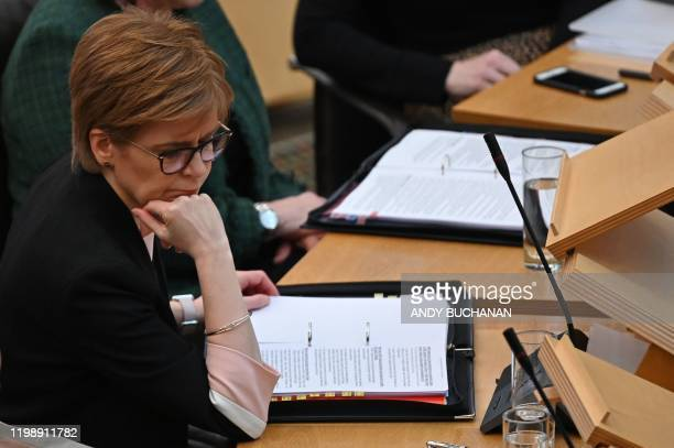 Scotland's First Minister, and leader of the Scottish National Party , Nicola Sturgeon reacts during First Minister's Questions at Holyrood, the seat...