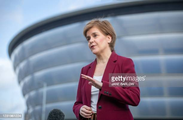 Scotland's First Minister and leader of the Scottish National Party , Nicola Sturgeon speaks to the media outside the Covid-19 vaccination centre at...