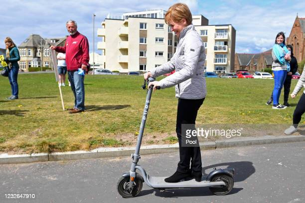 Scotland's First Minister and leader of the Scottish National Party , Nicola Sturgeon tries out a scooter as she campaigns with SNP candidate for...