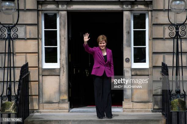 Scotland's First Minister and leader of the Scottish National Party , Nicola Sturgeon waves on the steps of her official residence Bute House in...