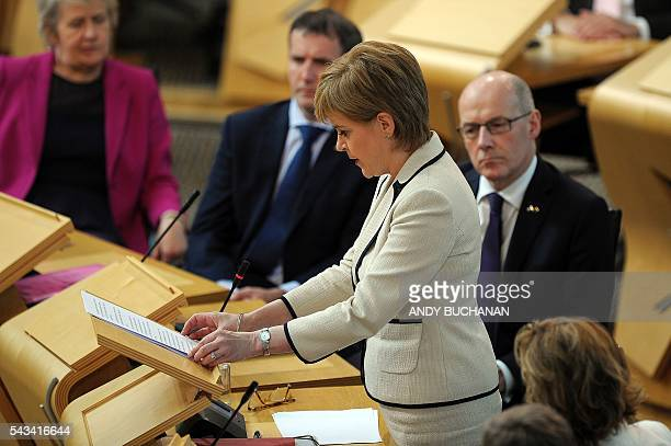 Scotland's First Minister and Leader of the Scottish National Party Nicola Sturgeon addresses the Scottish Parliament in a debate on the EU...