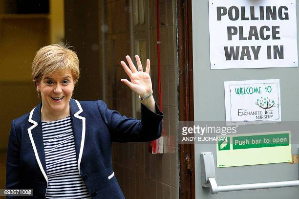 Scotland's First Minister and leader of the Scottish National Party Nicola Sturgeon gestures as she leaves a Polling Station after casting her ballot...