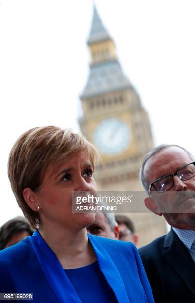 Scotland's First Minister and Scottish National Party leader Nicola Sturgeon speaks to members of the media in front of the Elizabeth Tower commonly...