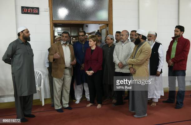 Scotland's First Minister and Scottish National Party leader Nicola Sturgeon meets worshippers during a visit to Dundee Central Mosque on June 21...