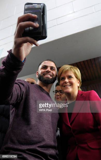 Scotland's First Minister and Scottish National Party leader Nicola Sturgeon poses for a 'selfie' photograph as she meets worshippers during a visit...