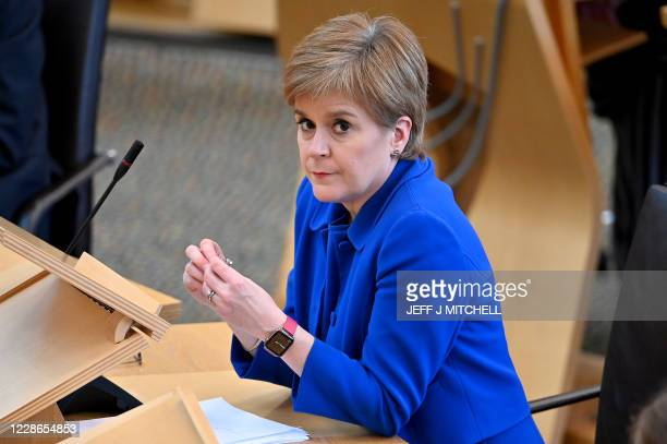 Scotland's First Minister Nicola Sturgeon announces her plans to halt the spread of coronavirus at the Scottish Parliament in Edinburgh, on September...