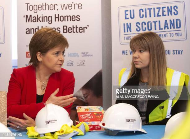 Scotland's First Minister Nicola Sturgeon chats to Training officer with Moretti Care Zofia Piotrowska during a visit to a building site to make a...