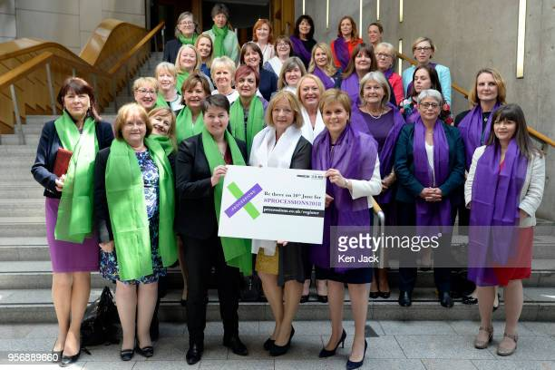 Scotland's First Minister Nicola Sturgeon Deputy Presiding Officer Linda Fabiani Scottish Conservative leader Ruth Davidson and female MSPs gather in...