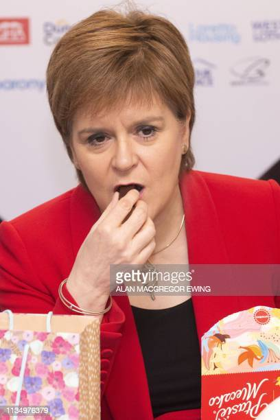 Scotland's First Minister Nicola Sturgeon eats a Polish chocolate during a visit to a building site to make a commitment to EU citizens that Scotland...