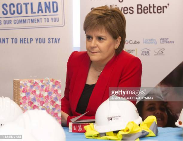 Scotland's First Minister Nicola Sturgeon gestures during a visit to a building site to make a commitment to EU citizens that Scotland would remain...