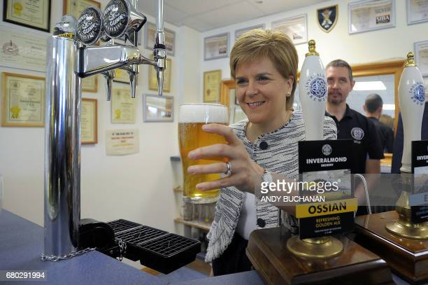 Scotland's First Minister Nicola Sturgeon gestures during her tour of the Inveralmond Brewery as she campaigns for the upcoming general election in...