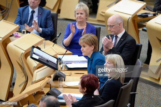 Scotland's First Minister Nicola Sturgeon is applauded by front bench colleagues as she resumes her seat during First Minister's Questions in the...